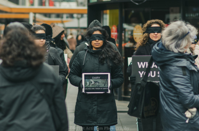 Women standing in a Save Square formation, wearing blindfolds
